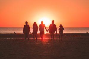 Unsplash, family, friends, beach, water, sand, holding hands, walking